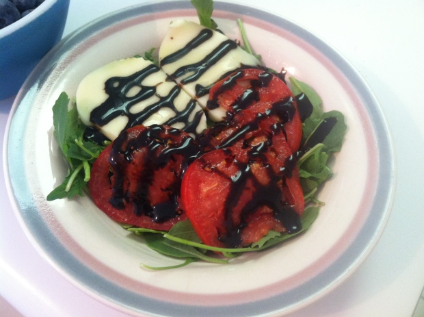 Caprese salad: sliced mozzarella and tomatoes on top of arugula. Dressing was olive oil + TJ's balsamic glaze