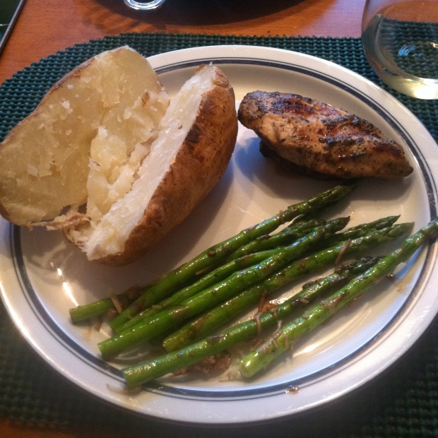 Grilled chicken, roasted asparagus with parmesan and balsamic vinegar, and half of a baked potato. Pinot Grigio on the side.